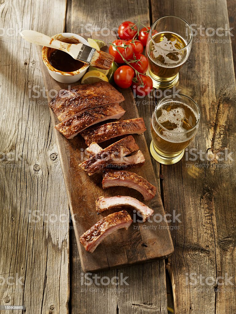 Baby Back Pork Ribs with a Couple of Beers stock photo