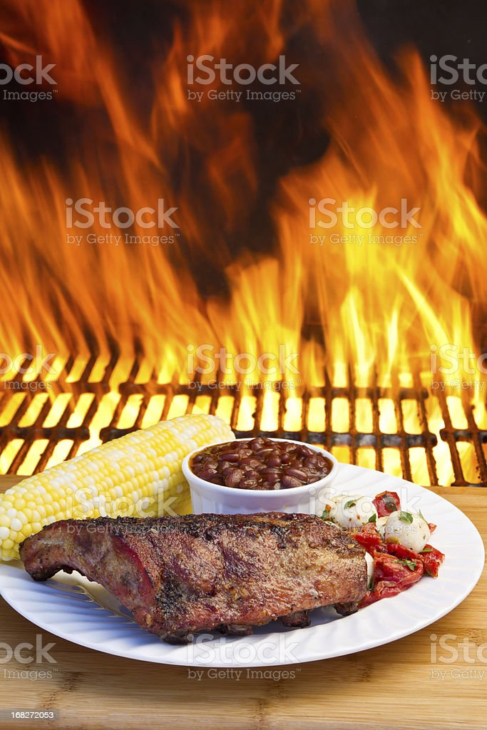 Baby Back Pork Ribs with Flames stock photo