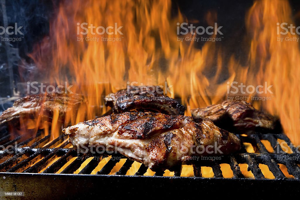 Baby Back Ribs on a Flaming Grill stock photo