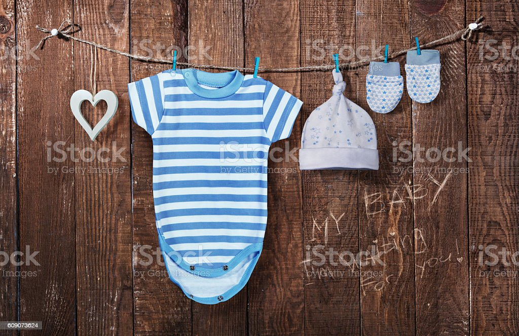 Baby background. Baby clothes hanging on the clothesline stock photo