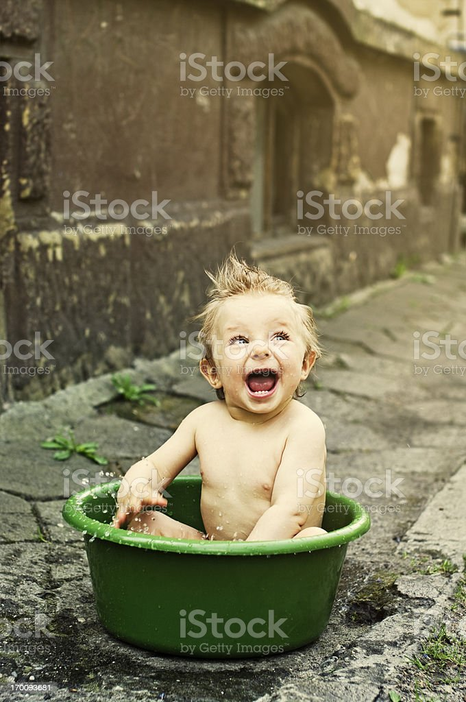 Baby bath in wash tub royalty-free stock photo