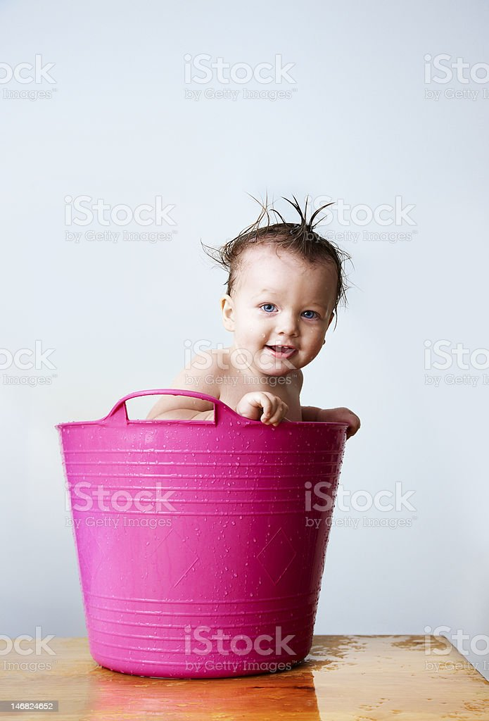 Baby bathing i pink tub royalty-free stock photo