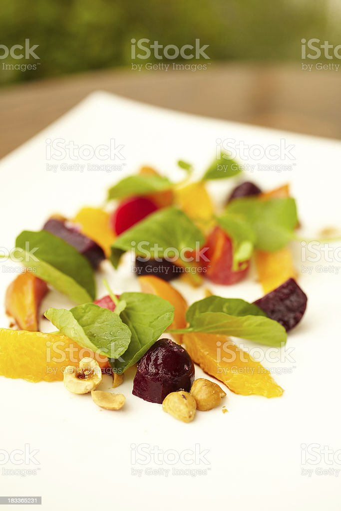 Baby beet salad with watercress and hazelnuts royalty-free stock photo