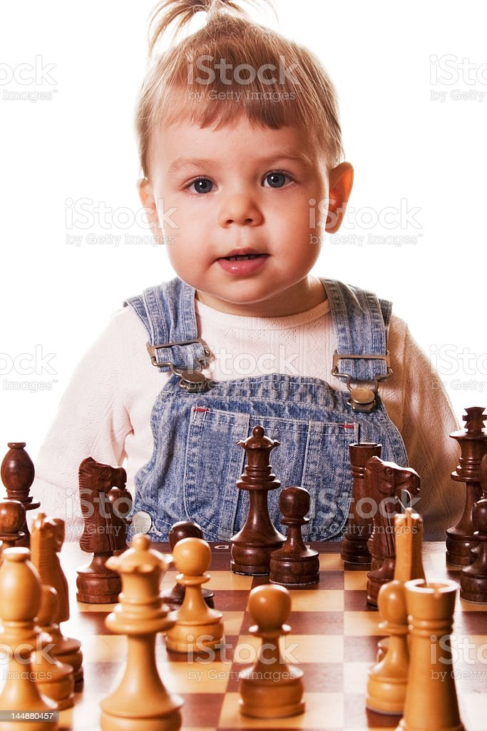 Baby behind Chess Desk stock photo