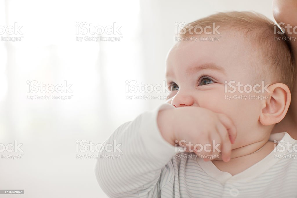 Baby biting thumb in mouth royalty-free stock photo