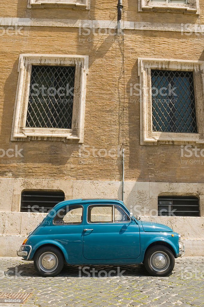 Baby blue car on cobbled street, Rome royalty-free stock photo