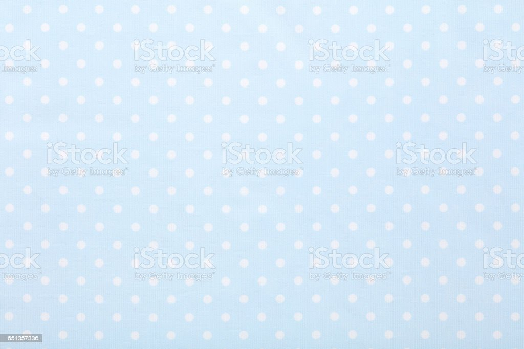 Baby blue polka dot fabric texture background stock photo