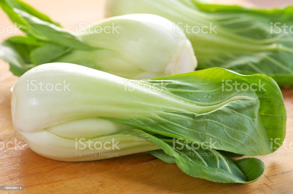 Baby Bok Choy on Wooden Cutting Board stock photo
