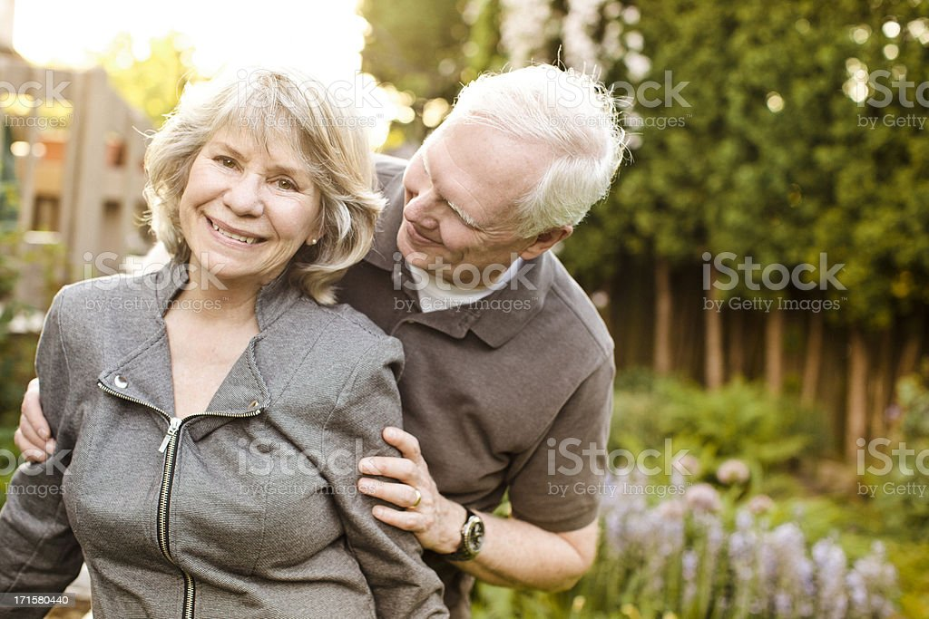 Baby boomer couple standing outside together. royalty-free stock photo