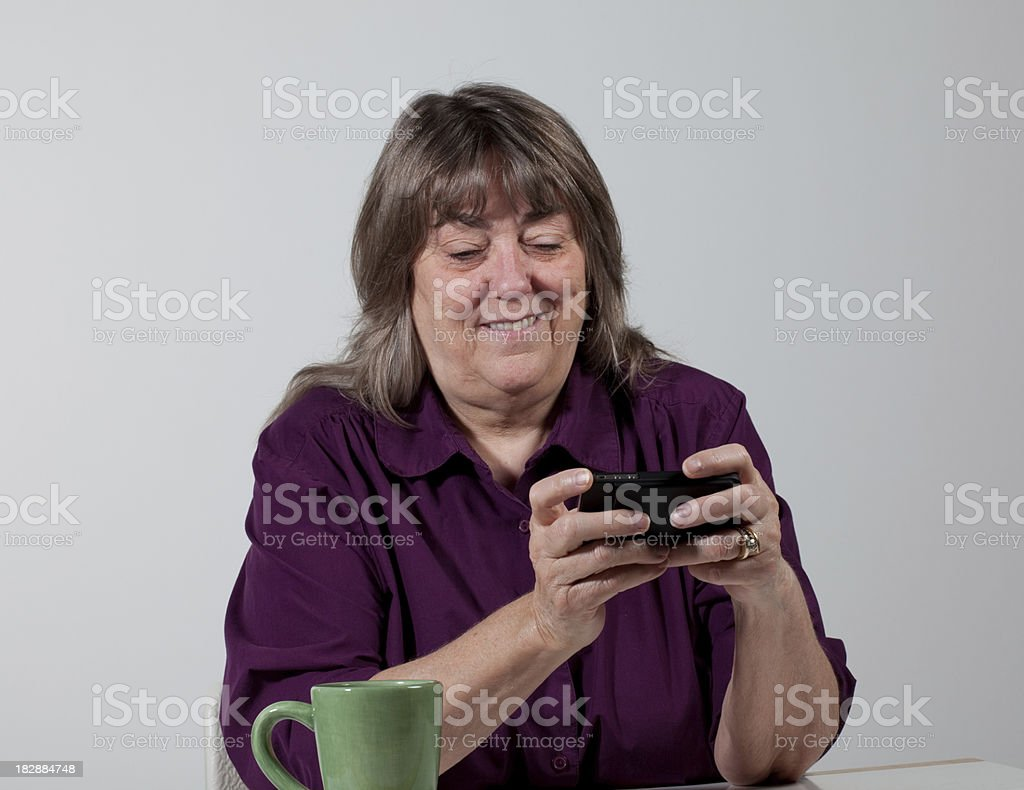 Baby boomer texting royalty-free stock photo