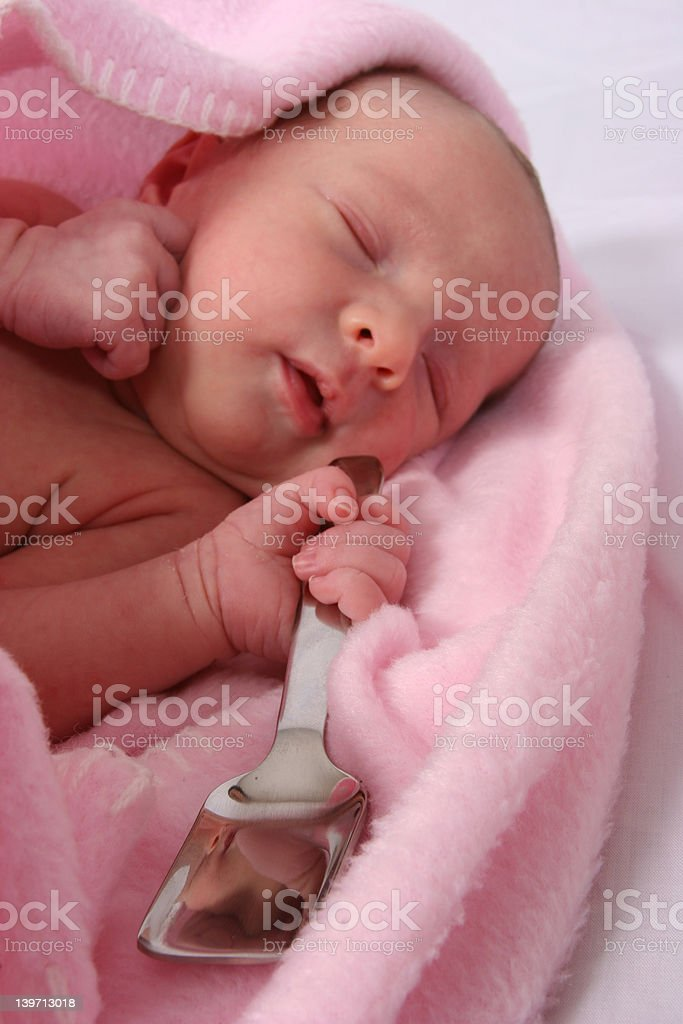 Baby born with silver spoon in her mouth royalty-free stock photo