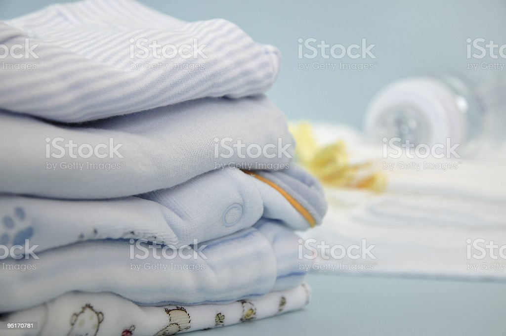 Baby Bottle and Clothes stock photo