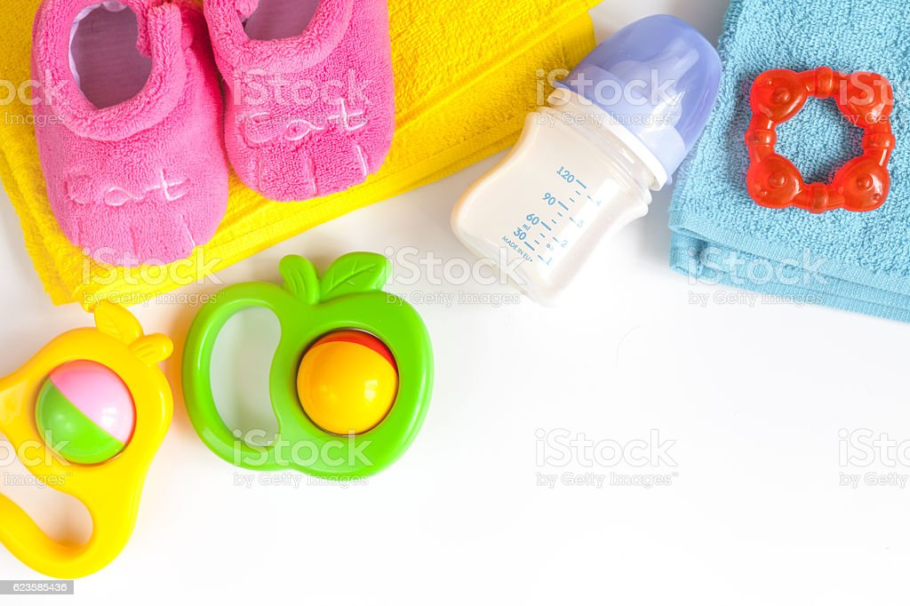 baby bottle with milk on white background top view stock photo