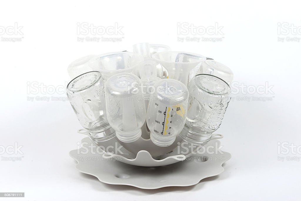 Baby bottles drying on a rack. stock photo