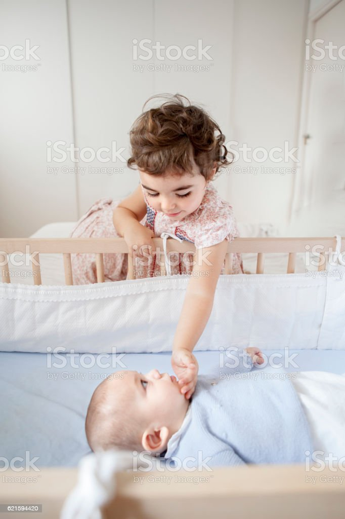Baby boy and big sister stock photo