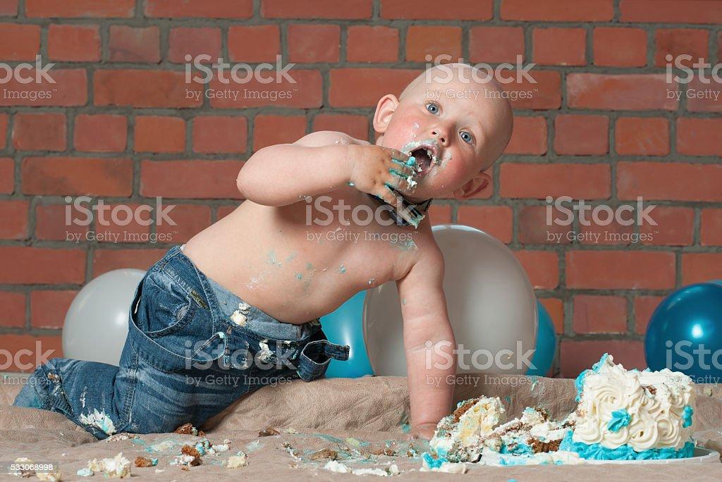 baby boy and cake stock photo