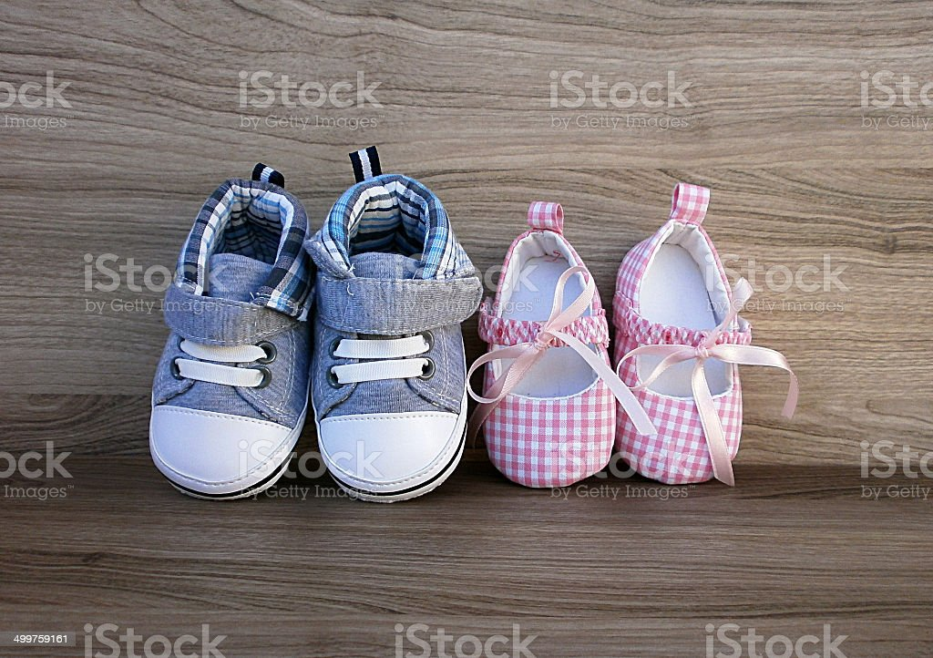 Baby boy and girl shoes stock photo