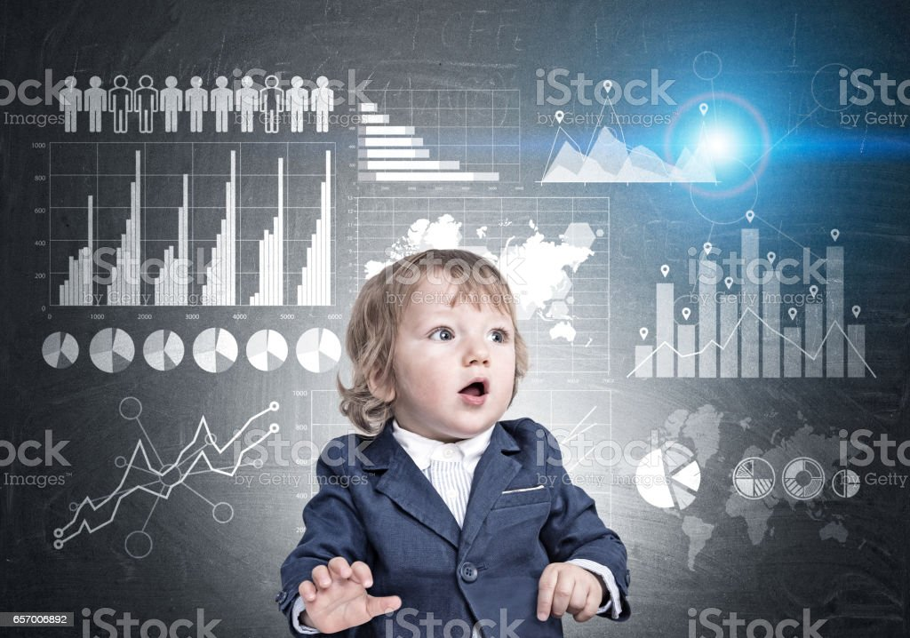 Baby boy and graphs on blackboard stock photo
