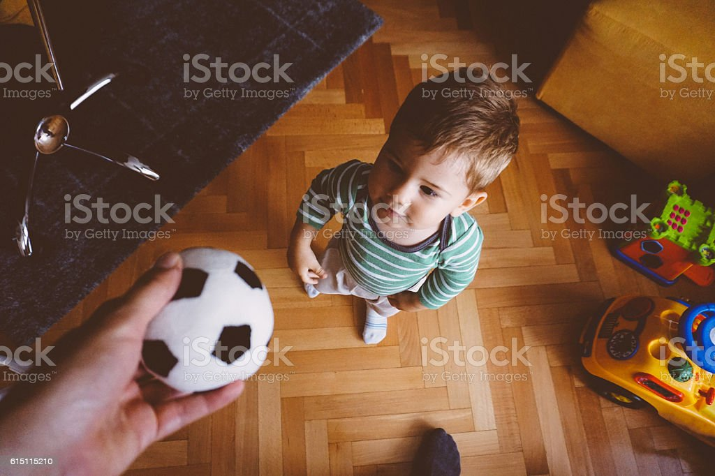 Baby boy and the ball stock photo