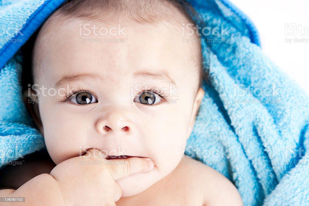 Baby Boy Chews on His Fingers Closeup stock photo
