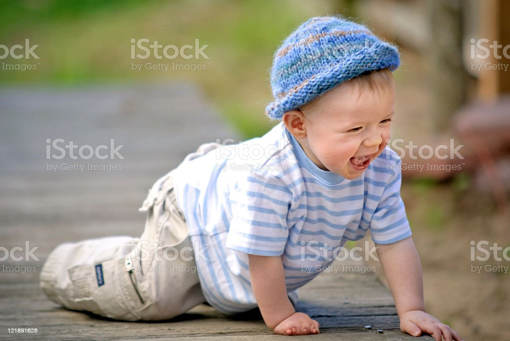 Baby Boy Crawling Outside stock photo