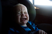 Baby boy crying in car seat