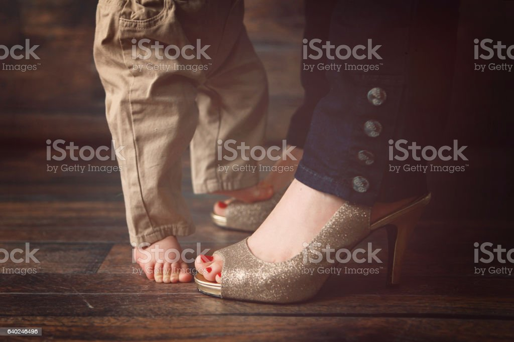 Baby Boy Dancing with his Mommy stock photo