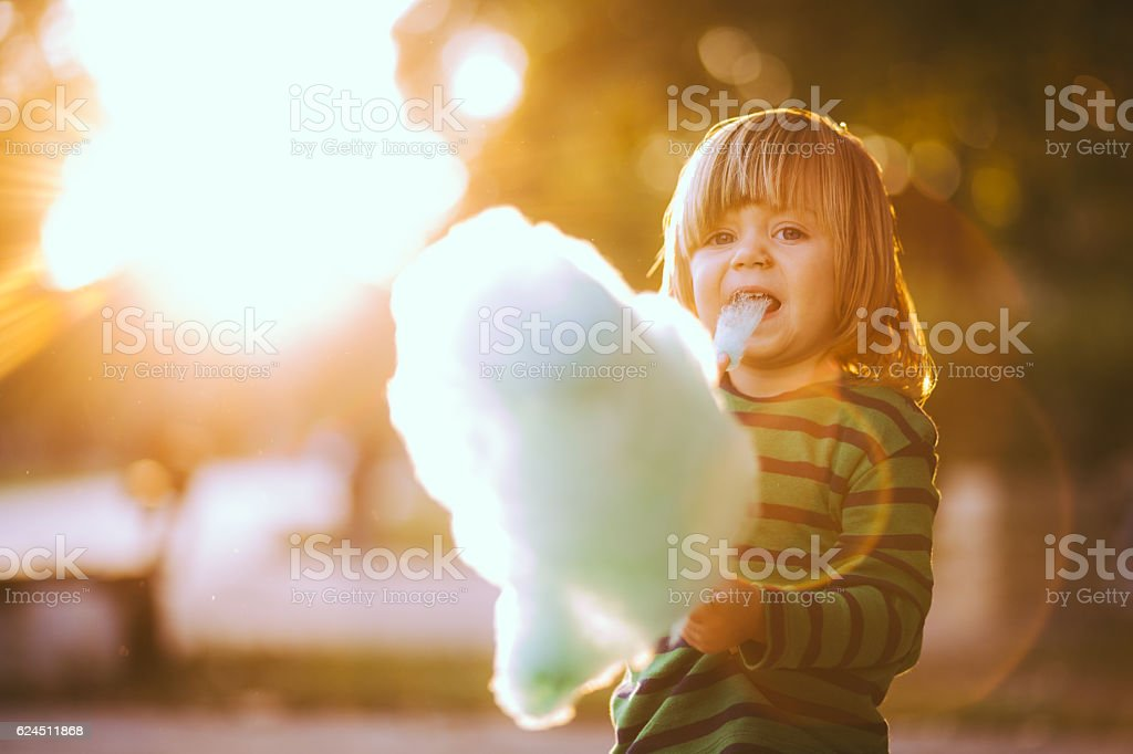 Baby Boy Eating Candyfloss stock photo