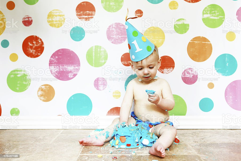 Baby Boy Eating First Birthday Cake stock photo