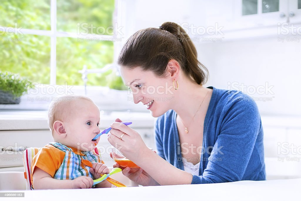 Baby boy eating his first solid food royalty-free stock photo