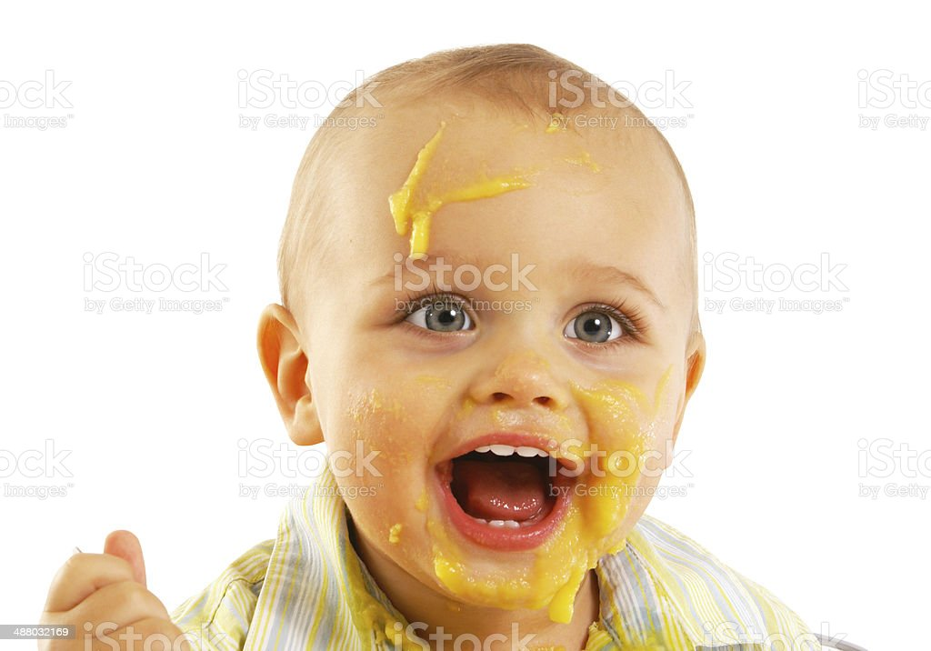 Baby boy eating pap stock photo