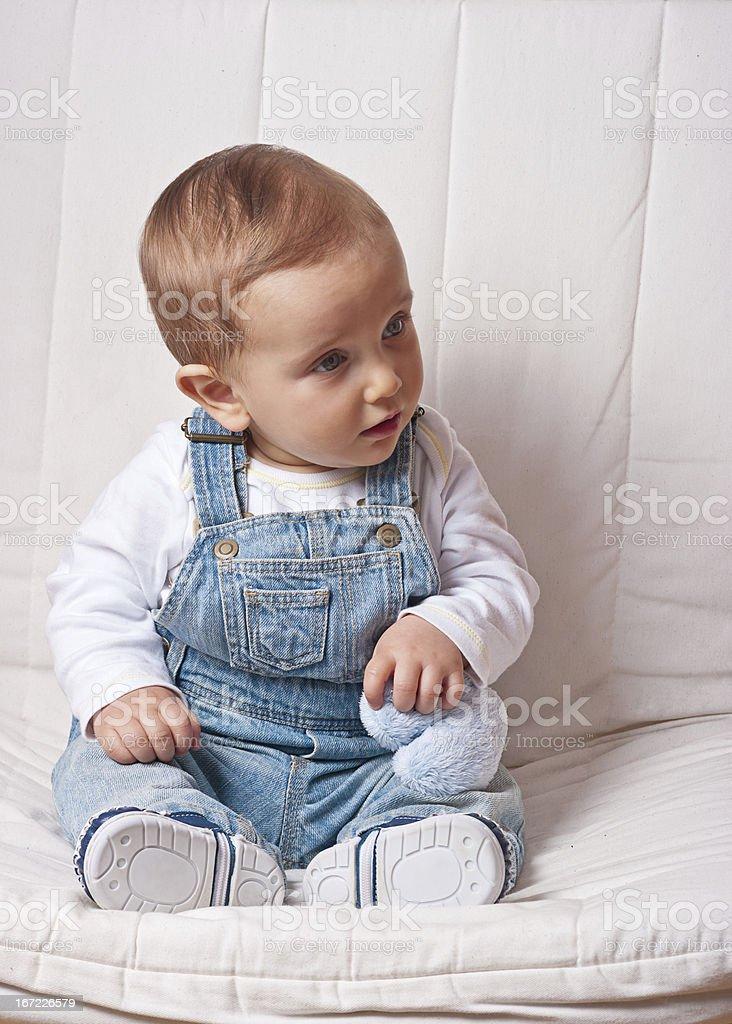 Baby boy holding a stuffed heart royalty-free stock photo
