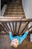 Baby Boy Holding Stair Gate