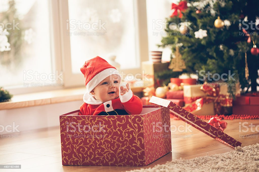 Baby boy in a Christmas box stock photo