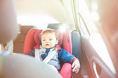 Baby boy in car seat watching DVD
