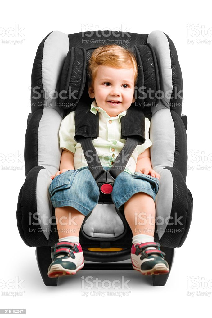 Baby boy in carseat isolated on white stock photo