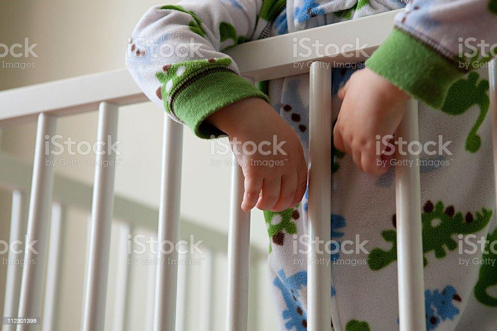 Baby boy in crib stock photo