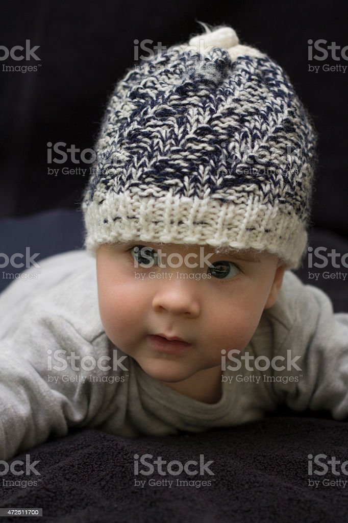 Baby boy in  knitted winter hat stock photo
