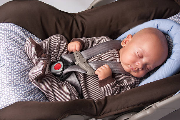 Baby Boy In Safety Seat Stock Photo