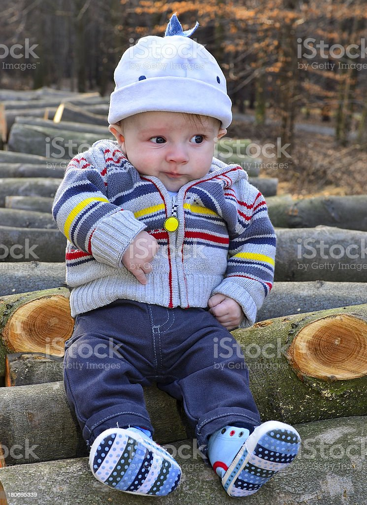 Baby boy in the forest stock photo