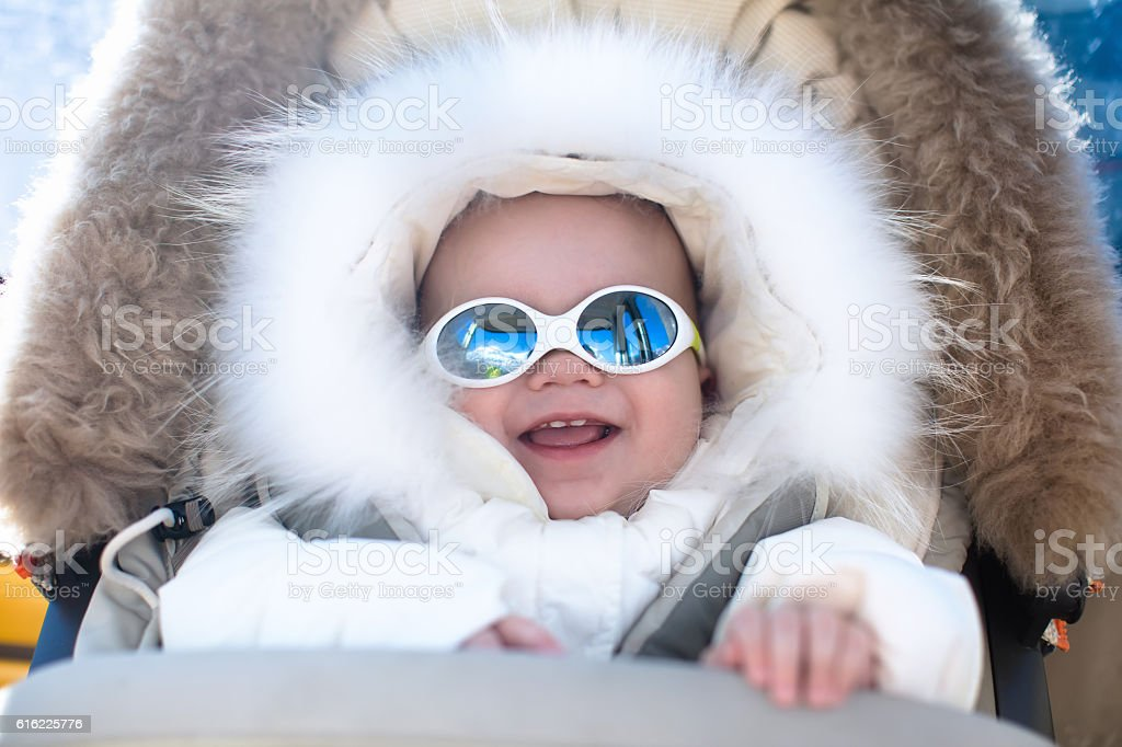 Baby boy in the mountains stock photo