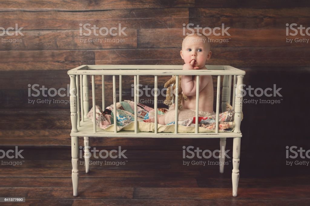 Baby Boy in Vintage Crib stock photo