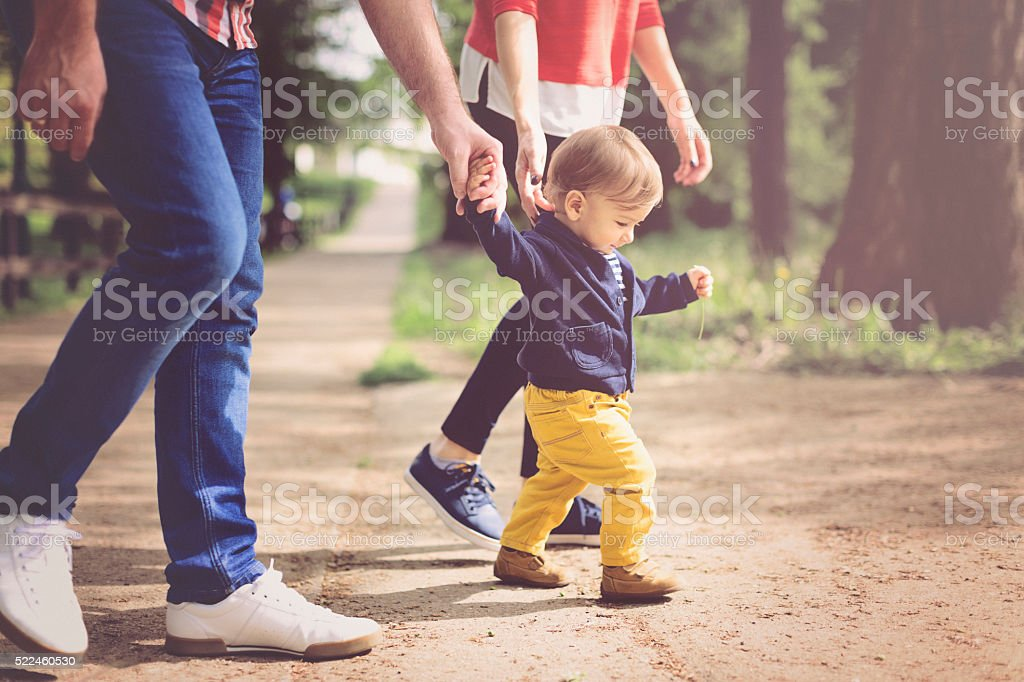 Baby boy learning to walk stock photo