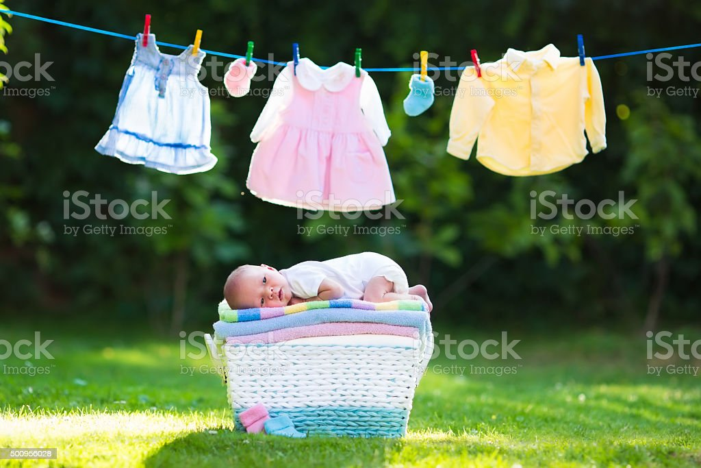 Baby boy on a pile of towels outdoors stock photo