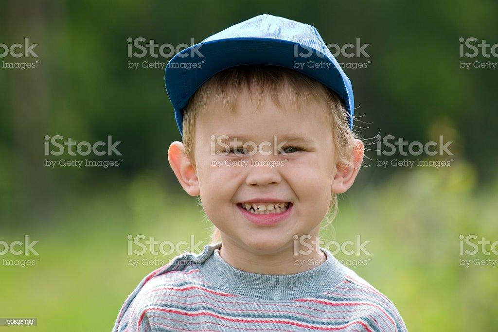 Baby boy on green stock photo
