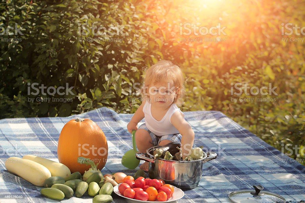 Baby boy on picnic stock photo