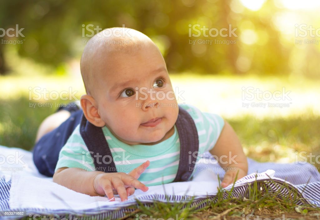 Baby boy on the grass stock photo
