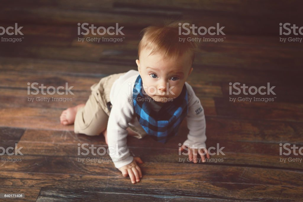 Baby Boy on the Verge of Crawling stock photo
