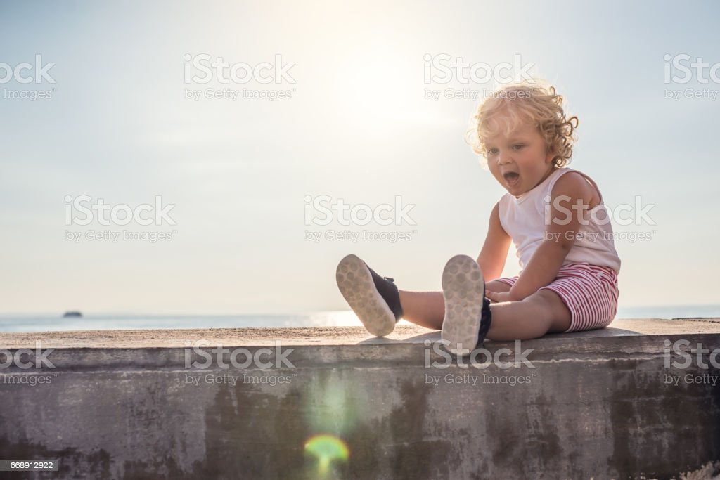 Baby boy on vacations stock photo