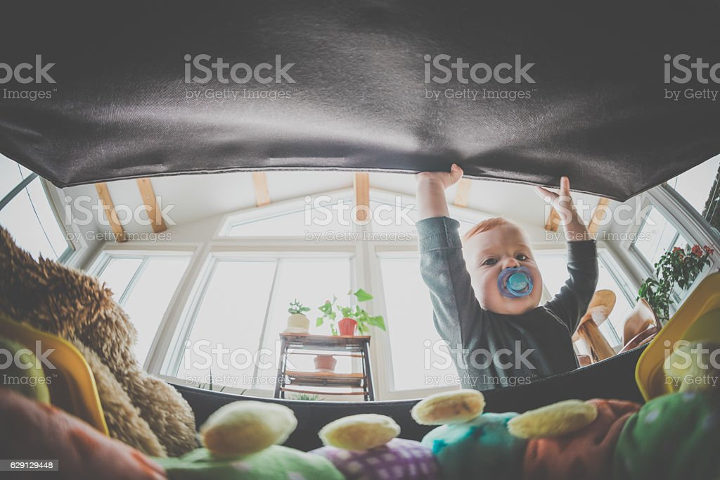 POV Baby Boy Opening Exploring and Looking Inside Toy Box stock photo